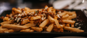 French fries topped with chili sin carne and melted cheese.